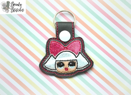 hair bow doll key fob in the hoop embroidery design by spunky stitches