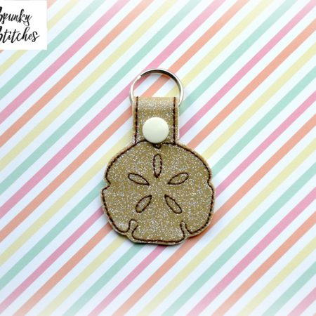 sand dollar key fob in the hoop embroidery file by spunky stitches
