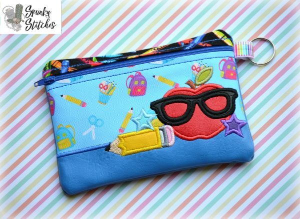 nerdy apple zipper bag in the hoop embroidery file by spunky stitches