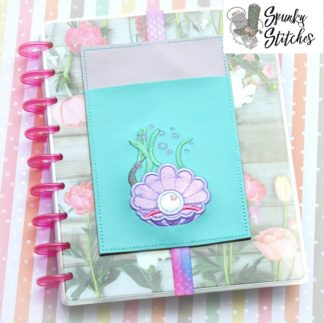 clam pocket planner in the hoop embroidery file by spunky stitches
