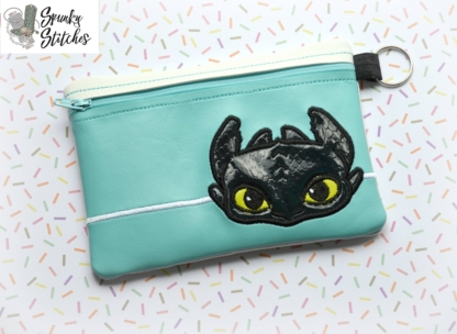 toothless zipper bag in the hoop embroidery file by spunky stitches