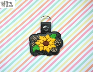 Sunflower key fob in the hoop embroidery file by spunky stitches