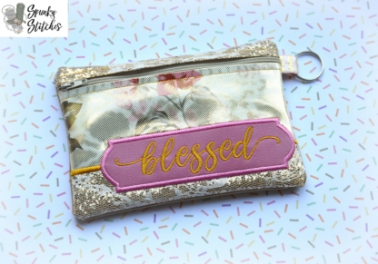 blessed zipper bag in the hoop embroidery file by spunky stitches