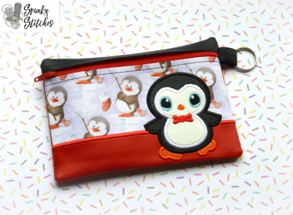 Penguin zipper bag in the hoop embroidery file by spunky stitches