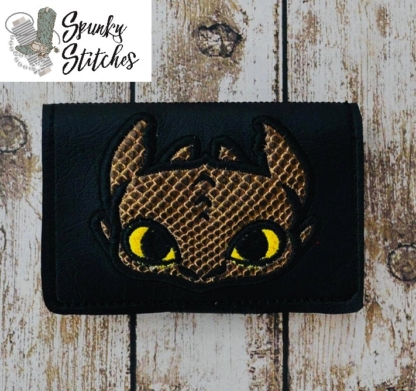 toothless zipper wallet mini key fob in the hoop embroidery file by spunky stitches