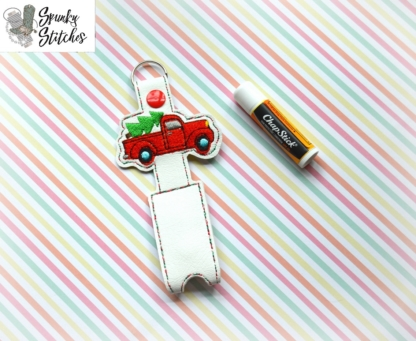 Christmas truck chapstick holder key fob in the hoop embroidery file by spunky stitches