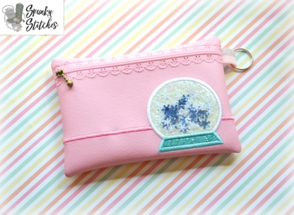 snowglobe Zipper Bag in the hoop embroidery file by spunky stitches