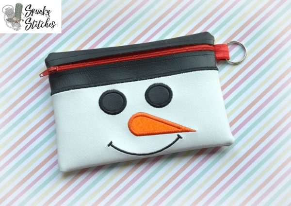 Snowman zipper bag in the hoop embroidery file by spunky stitches
