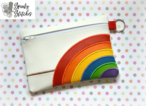 Rainbow zipper bag in the hoop embroidery file by spunky stitches