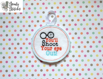 Shoot your eye out ornament in the hoop embroidery file by spunky stitches