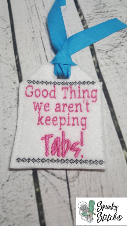 Not Keeping Tabs gift tag in the hoop embroidery file by spunky stitches