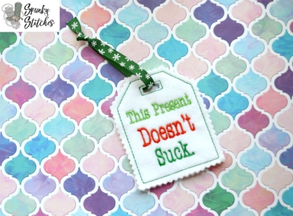 Doesn't suck gift tag in the hoop embroidery file by spunky stitches