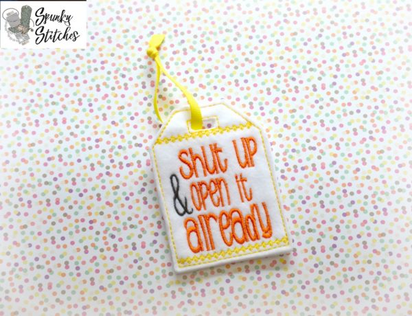 shut up gift tag in the hoop embroidery file by spunky stitches