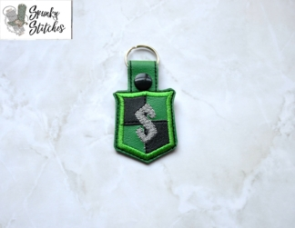 Slytherin key fob in the hoop embroidery file by spunky stitches