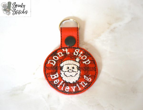 Don't stop believing key fob in the hoop embroidery file by spunky stitches
