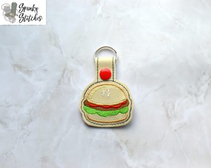 Burger key fob in the hoop embroidery file by spunky stitches.