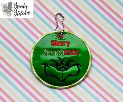 merry grinchmas ornament in the hoop embroidery file by spunky stitches.