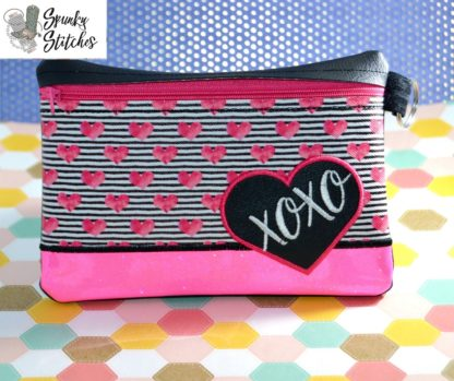 xoxo heart zipper bag in the hoop embroidery file by spunky stitches.