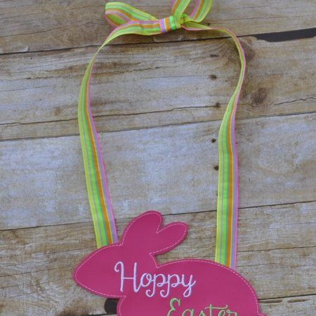 hoppy easter door hanger in the hoop embroidery file by Spunky stitches