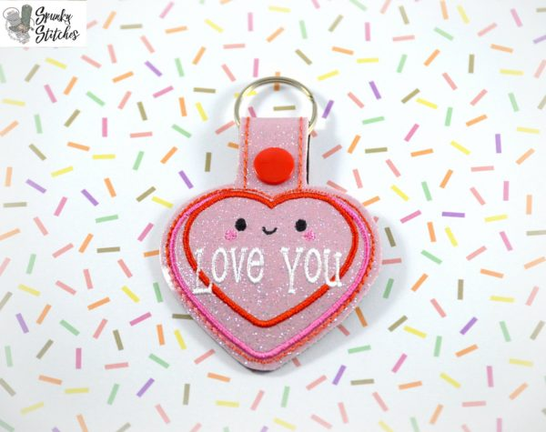 love you key fob in the hoop embroidery file by Spunky stitches