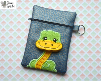 Snake Flap zipper bag in the hoop embroidery file by Spunky stitches