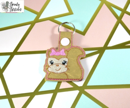 Squirrel Girl key fob in the hoop embroidery file by Spunky stitches