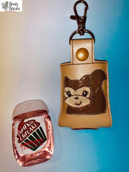 Squirrel sanitizer holder in the hoop embroidery file by Spunky stitches