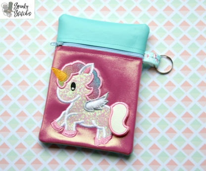 Unicorn Flap zipper bag in the hoop embroidery file by Spunky stitches