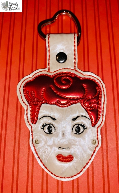Lucy Face Key Fob in the hoop embroidery file by Spunky stitches