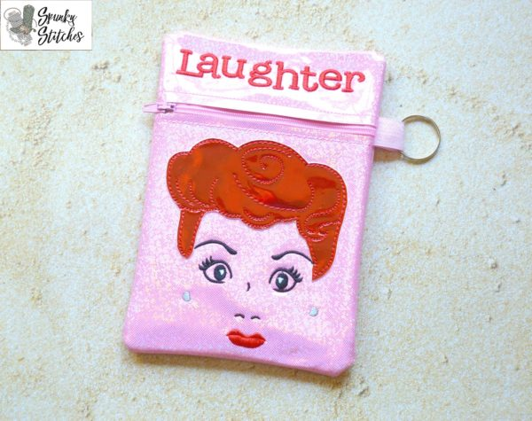 Lucy Laughter zipper bag in the hoop embroidery file by Spunky stitches