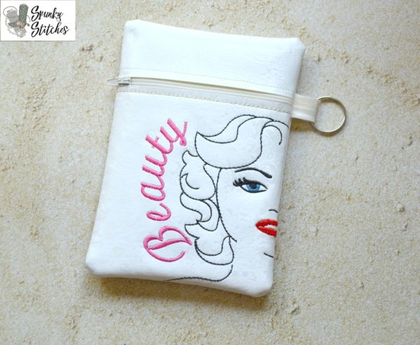 Marilyn zipper bag in the hoop embroidery file by Spunky stitches