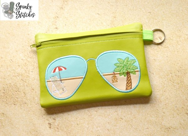 Sunglasses zipper bag in the hoop embroidery file by Spunky stitches