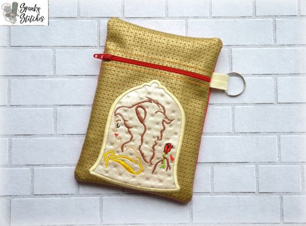 Beauty and Beast zipper bag in the hoop embroidery file by Spunky stitches