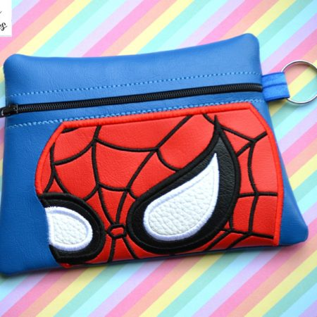 Spiderman face zipper bag in the hoop embroidery file by Spunky stitches