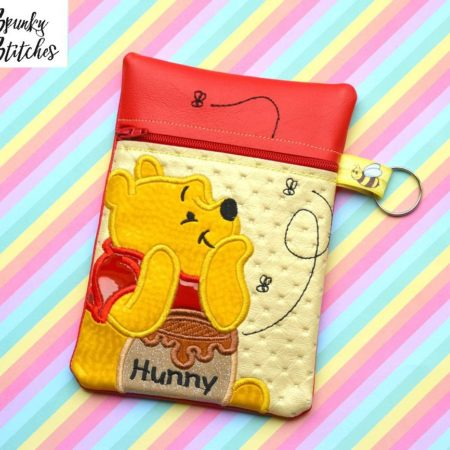 Pooh zipper bag in the hoop embroidery file by Spunky stitches
